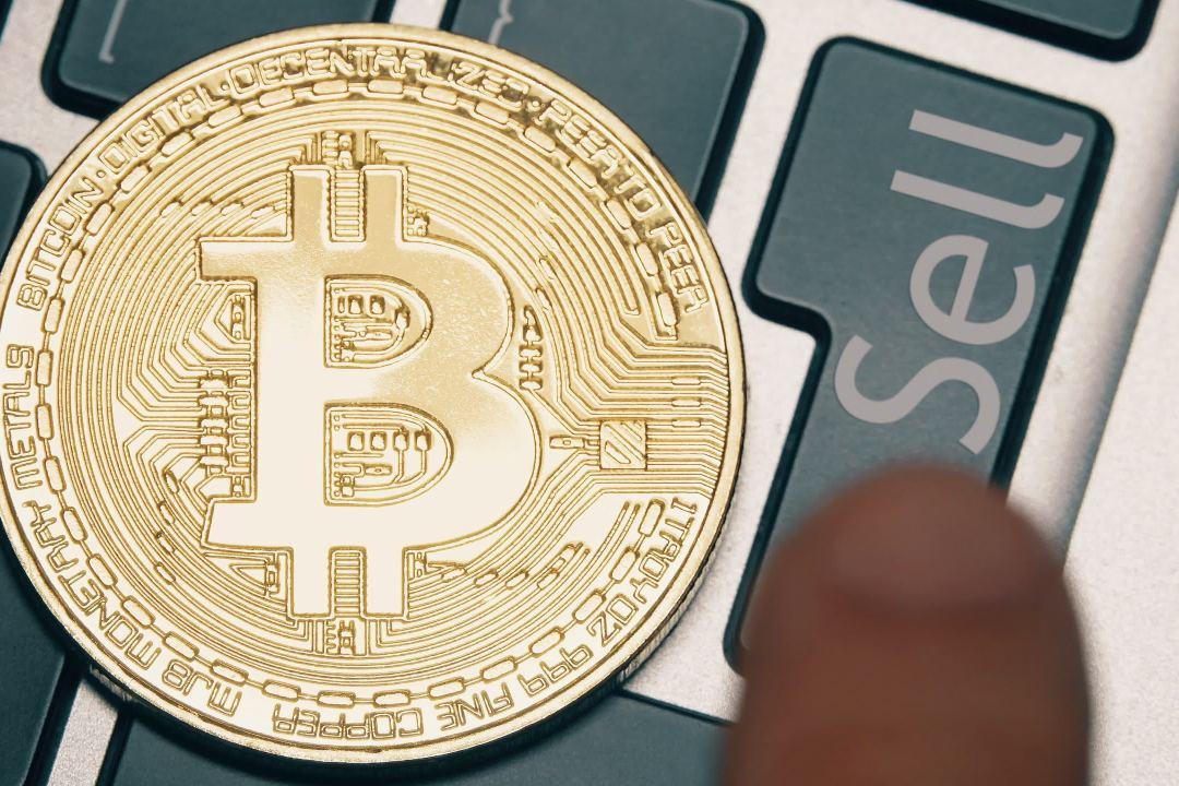 """Bloomberg: l'indicatore del trend di bitcoin dice """"sell"""""""
